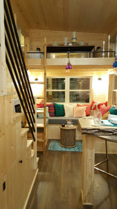 Tiny house living area, U-shape couch with ladder to second loft - Glenmark Construction Inc
