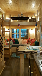 Tiny house living space with aerial lights - Glenmark Construction Inc