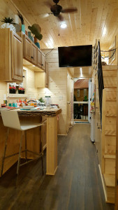 Tiny house view of galley kitchen and stairs to master loft - Glenmark Construction Inc